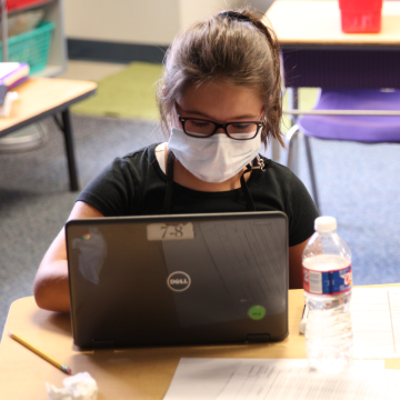 Elementary student working on a chromebook