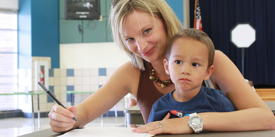 A mother with her Denton ISD student