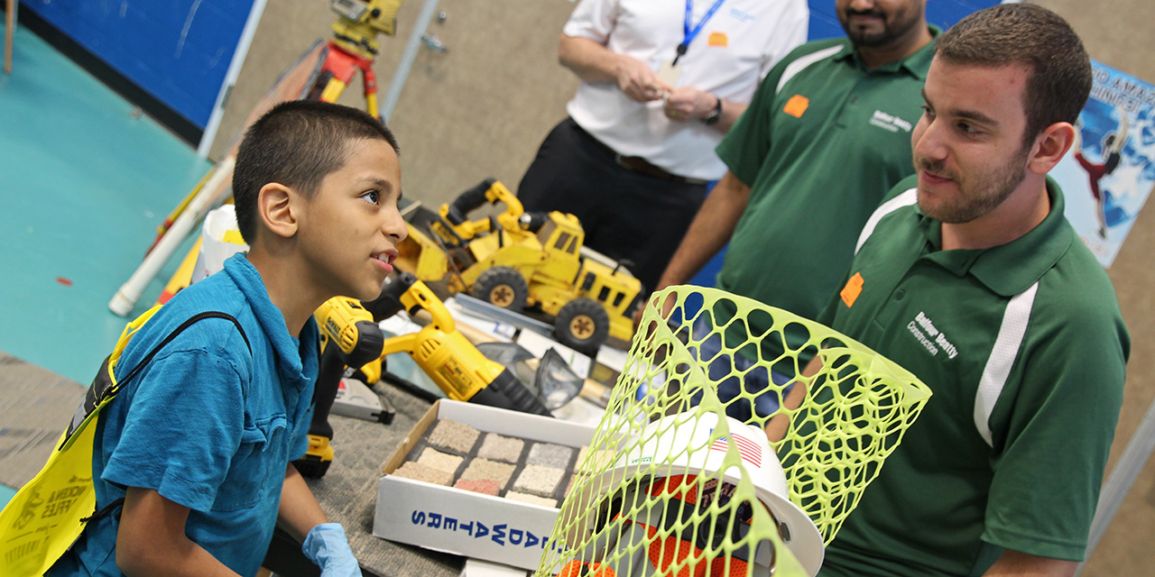 A Stephens Elementary student watches a Balfour Beatty presentation
